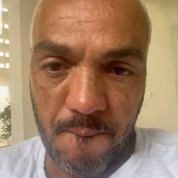 Após deixar a prisão, Belo surge abatido em vídeo e chora: 'Grito em silêncio'