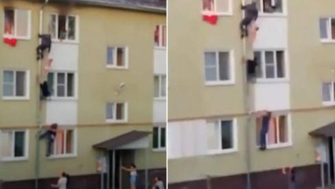 Homens escalam fachada de prédio para salvar três crianças de incêndio